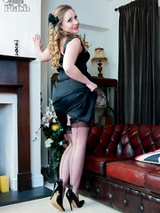 Our all natural Sophia is with you, looking radiant in a tight black satin dress.