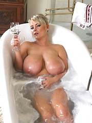 Bea Flora in bathtub with champagne